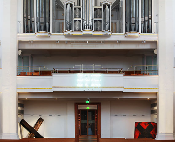 Neon, installation view at Johanneskirche, Dusseldorf. Crosses below: work by Manfred Rennertz