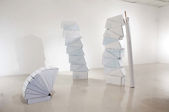 Mixed media, cardboard boxes, white paint, white duct tape, variable dimensions, 2012.