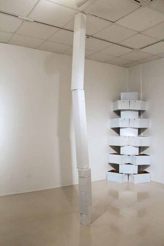 Mixed media, cardboard boxes, white paint, white duct tape, variable dimensions, 2012. From the installation Unspecific Shapes