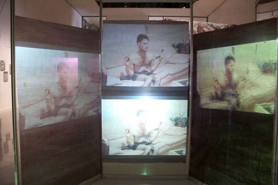 4-channel video installation, 2012; aluminum, plexiglas construction, garbage bags.