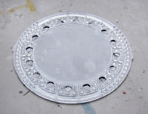 resin, 95cm diameter. A real size replica of a manhole cover in Dusseldorf